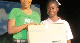The winner Darla Willie receives her prize from LIME's SharleneJn Baptiste.