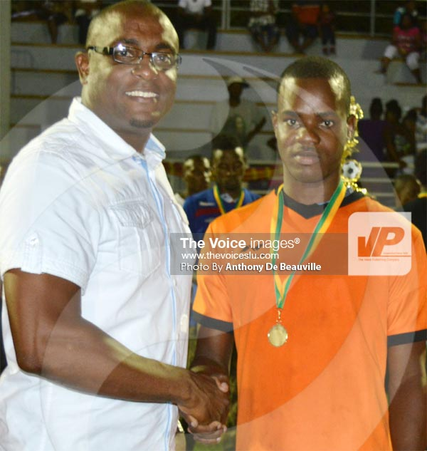 Image: Kentus Brown seen here receiving his medal from Sports Minister Shawn Edward created history when he scored the winning goal for Survivals in extra time. (PHOTO: Anthony De Beauville)