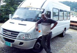 Craston poses with his new bus.