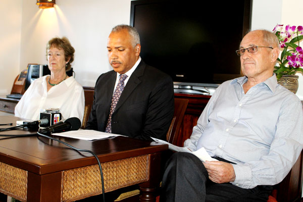 Photo of Attorney Peter Foster reads a statement on behalf of the Gobat family. Seated with him are Helen and Theo Gobat. [Photo: Stan Bishop]