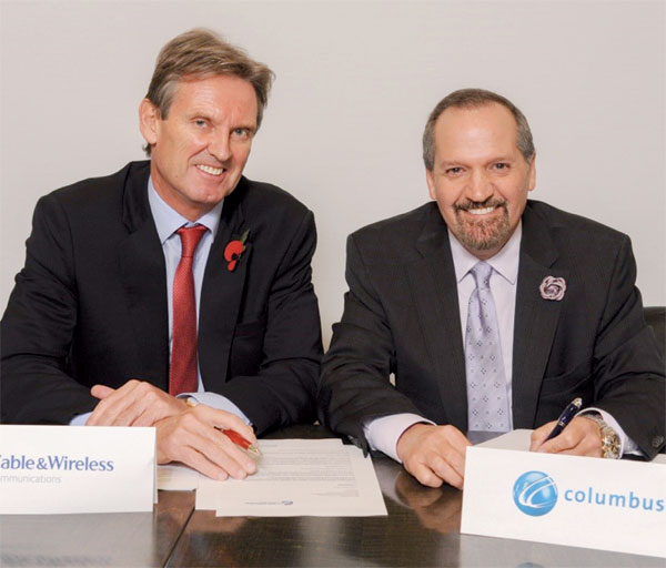 Phil Bently, Chief Executive Officer of Cable and Wireless Communications (left) and Brendon Paddick, CEO and Chairman of Columbus Communications