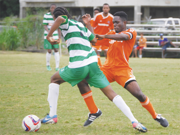 Tuff tassel for the ball between Northern United player Ameris Gilbert and VSC Captain Jonathan Symphorien. (PHOTO: Anthony De Beauville)
