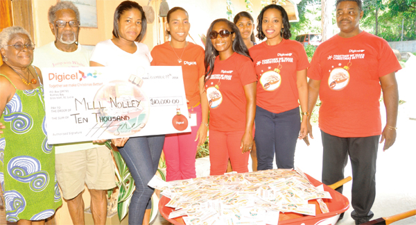 Mell Nolley with his wife and Digicel team members.