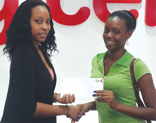 Lambert's grand daughter, Sharine Augustin (right) collects her winnings.