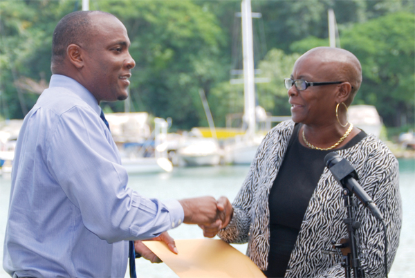 (L-R) Minister for Youth Development and Sports Shawn Edward receiving SLOC financial statement from President Fortuna Belrose (PHOTO: Anthony De Beauville)