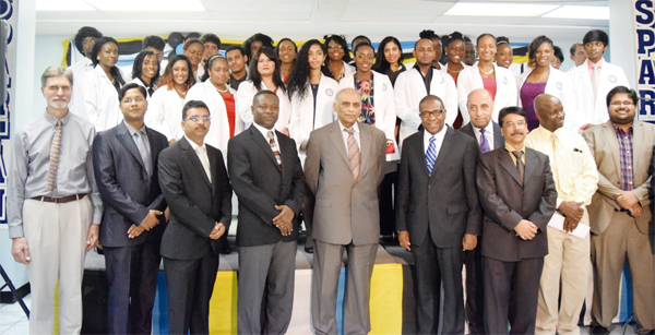 Minister Alva Baptiste, Directors, Faculty and new medical students.