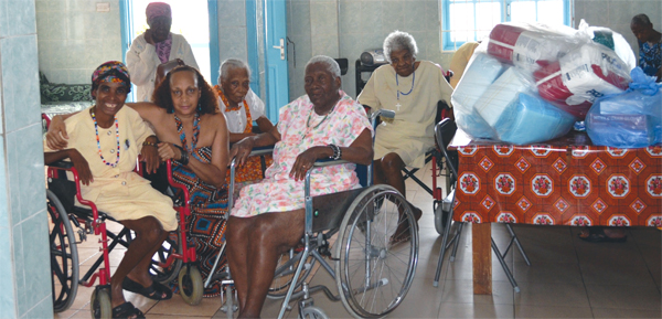 Ms. John (second from left) with some of the elderly  recipients.