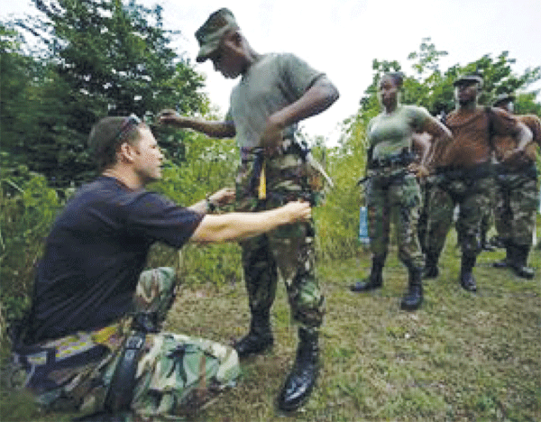 U.S. soldiers training St. Lucian policemen during one of several exercises before Washington suspended all assistance to the Police Force.