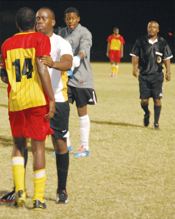 A Gros Islet player trying to calm down No. 14 from Soufriere [Photo: Anthony De Beauville]
