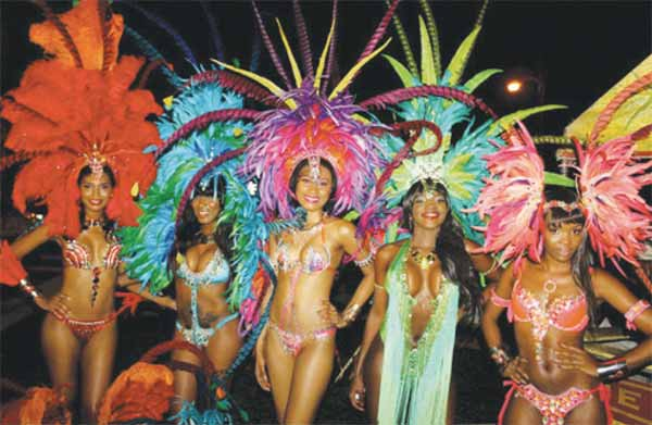 Insaniti Carnival Band's costume sections on display at last Saturday's official launch. [Photo: Stan Bishop]