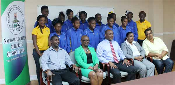 Photo moment for team St. Lucia along with Minister for Youth Development and Sports, other ministry officials and President SLNNA Liota Charlemagne - Mason. [Photo: Anthony De Beauville]