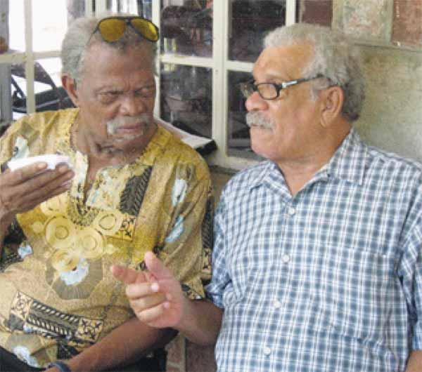 With life-long friend Derek Walcott.