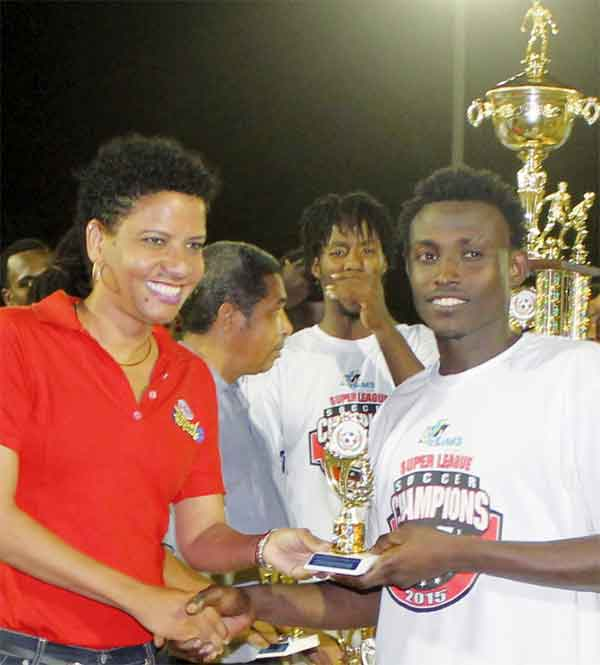 Gros Islet goal scorer No. 9 Troy Greenidge Receiving his award from Brand Manager for Grace Foods at Peter and Company. (Photo: Anthony De Beauville)