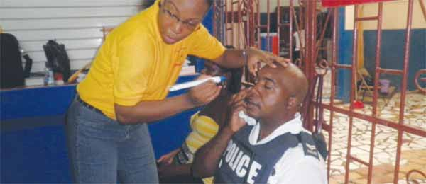 A police officer gets an eye check at SLBWA.