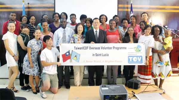 Ambassador Chang, his wife, students of the Speak Chinese programme and Taiwan/ICDF Overseas Volunteer Programme in Saint Lucia. [Photo: Stan Bishop]