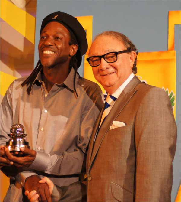St. Lucia Tennis Association President Steven Mc Namara presenting tennis playing Vernon Lewis with ITF/David Cup Commitment Award. [Photo: Anthony De Beauville]