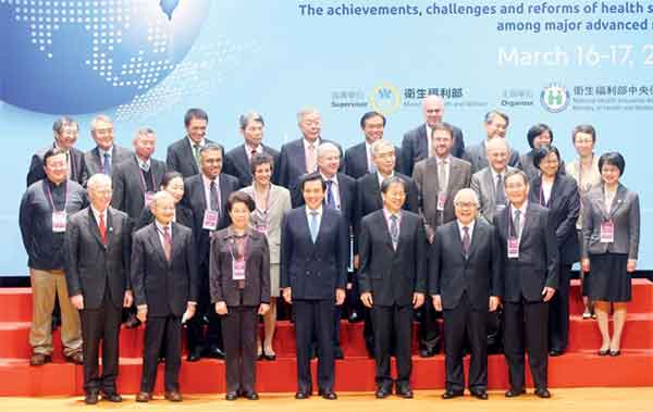 """President Ma Ying-Jeou (Front-Center)  and Mr. Chiang  Been-Huang, Minister of Health & Welfare  (Front-right 3) attend """"Taiwan's National Health Insurance 20th Anniversary  Symposium and round table"""" , March 16th, 2015"""