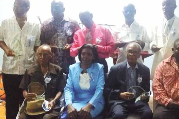 Image: M.P. Ms. Emma Hippolyte with the honourees.