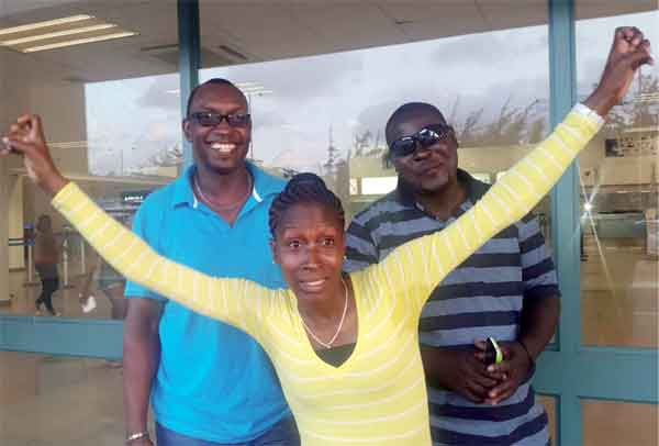Gaius Harry (Brand Manager) Dwaine Talbert and Melissa Talbert at the Hewanorra International Airport shortly before departure Wednesday.
