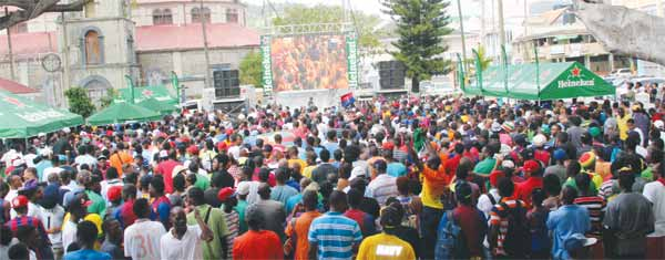 Image: The massive crowd at the Derek Walcott square Saturday during the Heineken viewing party for the UEFA Champions League Final.