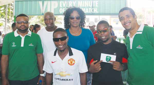 Image: WLBL's Sylvester Henry (left) and Thomas Leonce (right with VIP winner Ms. Carol Gideon and friends.