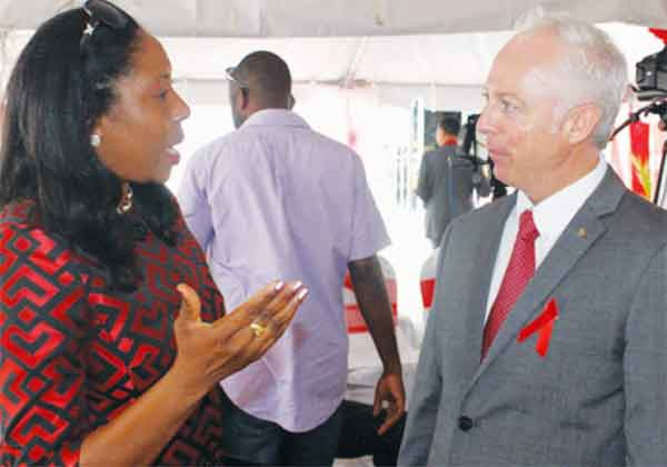 Health Minister Alvina Reynolds converses with Scotiabank Saint Lucia Country Manager, Philip Cross. [Photo: Stan Bishop]
