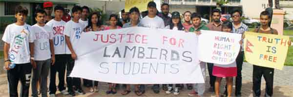 Former Lambirds Academy students protesting in Constitution Park yesterday afternoon. [Photo: Stan Bishop]
