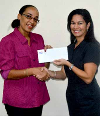 Image: Ms. Judy Deterville representing In Time Education Television, accepting a cheque from Mrs. Marella Deveaux, Marketing Manager M&C Group of Companies