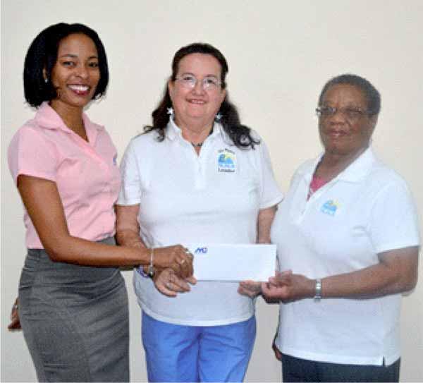 Image: ,Ms. Fern Wilson, presents the cheque to Mrs. Nancy Gomez, SLALA Floor Member, and Mrs. Margaret Rudder Mitchell, SLALA Treasurer.