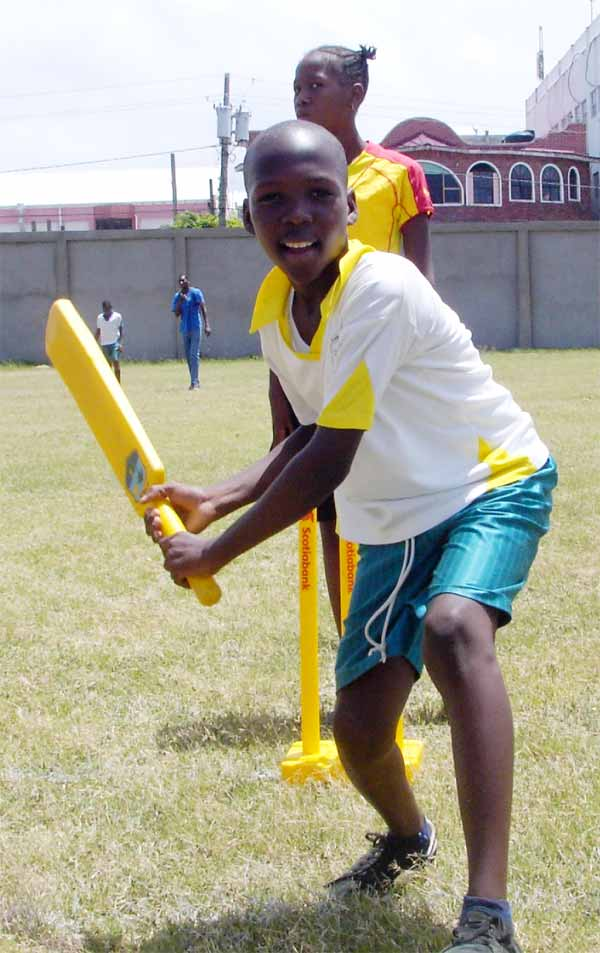 Image of A young batsman in action during the festival