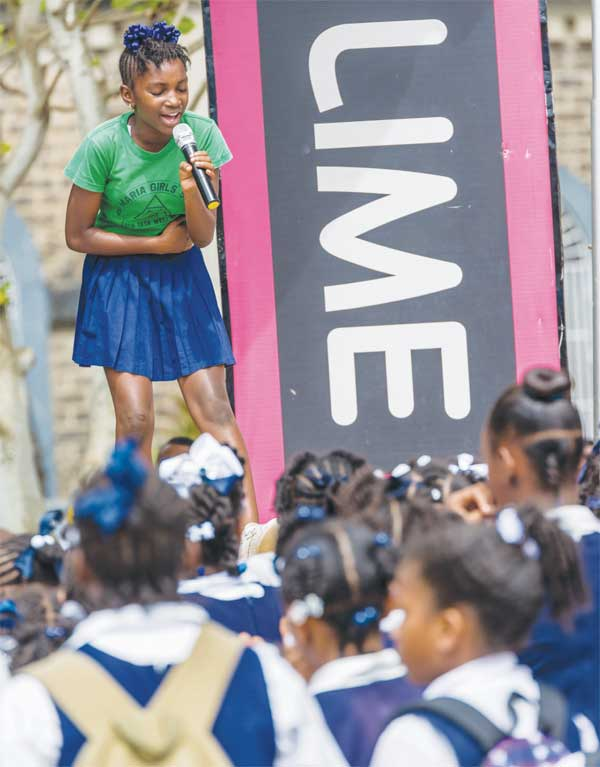 Image of Reigning National Primary School Calypso Monarch, Denisha 'Teeny D' Danzie in action.