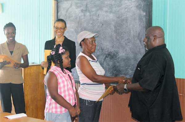 One of the beneficiary students collects her package.