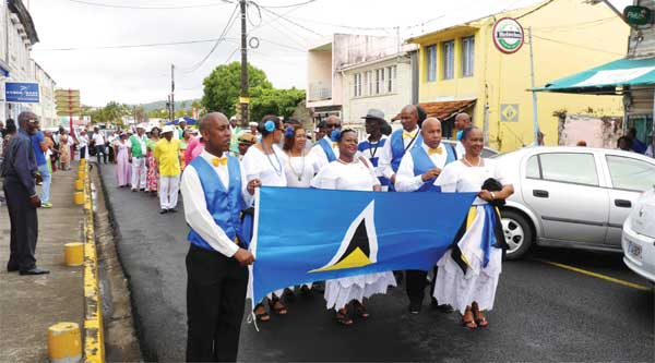 Image: The St. Lucians join the parade through the streets.