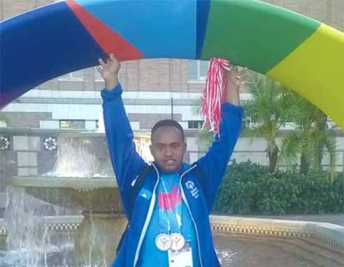Gold medal moment for St. Lucia Cecil Fevriere. (photo: St. Lucia Special Olympics)