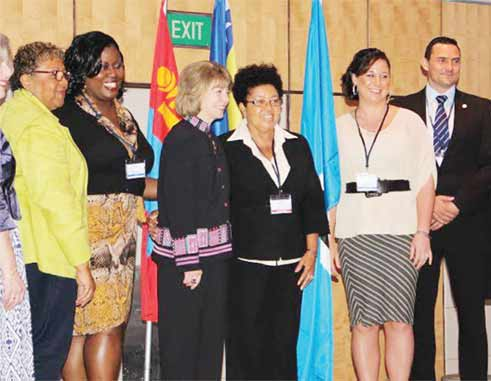 In photo fifth and sixth from left Ms.EyontheHusbands andMs. Crystal Showers with members of WCPT in Singapore.