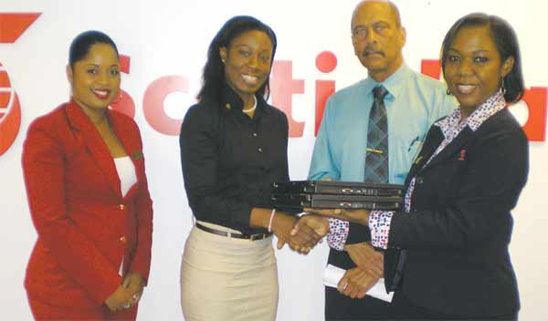 Pictured above from left to right are: Kristal Khodra-Auguste, Documents Officer at Scotiabank, Genelle Nelson, General Manager of NBTH, Andre Cherebin of the Rotary Club, and Beverly Gideon, Personal Banking Manager at Scotiabank.