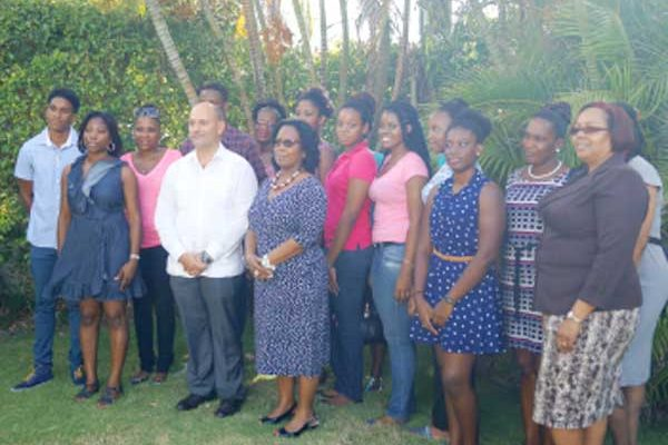 Ambassador Soberon (Fourth from left) with scholarship winners and St. Lucia government officials.