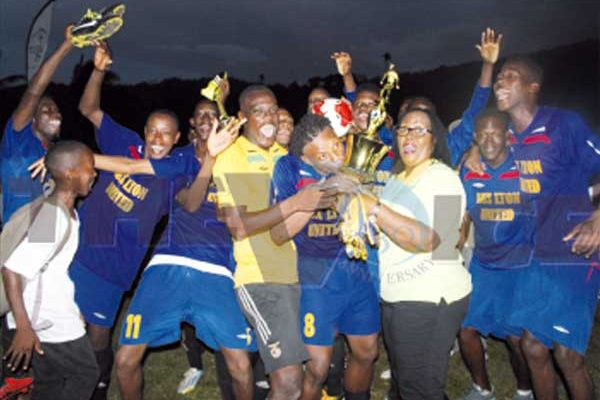 Celebration time for Aux Lyons United as EC Global Insurance Manager Anne Marie Herman presents the championship trophy. (Photo: Anthony De Beauville)