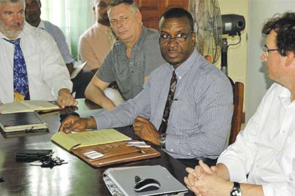 WASCO CEO Vincent Hippolyte (centre) discussing the de-silting project with stakeholders.