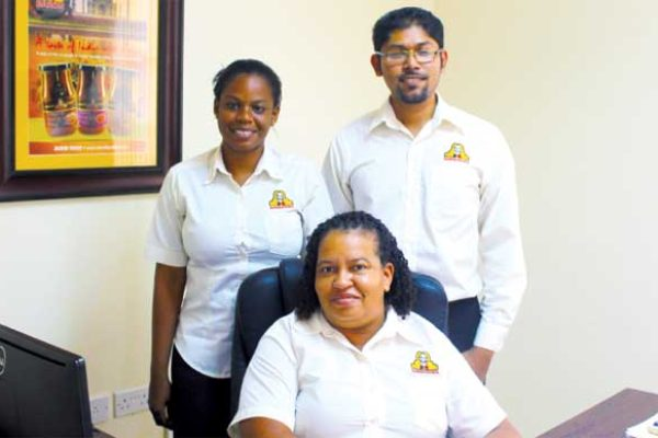 (L) to (R) Ms. Cardee Alexis, Ms. Geanelle Edgar (seated), and Mr. Hemaindra Ramjattan.