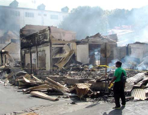 A resident surveys the destruction