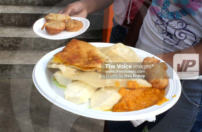 Dhalpuri, roti and goolagoola were among the crowd's favourites.(Photo by Stan Bishop)