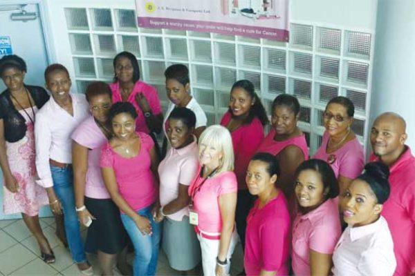 Image: J. E. Bergasse staff wearing pink.