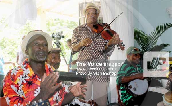"""Image: Band leader Augustin """"Charley"""" Julian and some of the band members performing at the Folk Research Centre. [PHOTO: Stan Bishop]"""