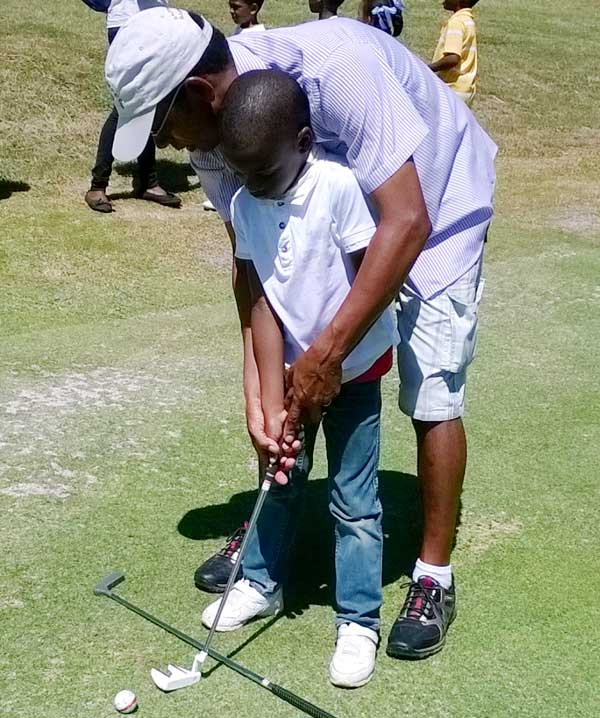 Image: Pro golfer Timothy Mangal with one of the young and aspiring golfers.(PhotoL SD)