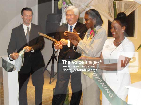 Image: The ribbon cutting ceremony, left to right: Luis Molina – Spa Director, Mark Ozawa – Windjammer Landings managing Director, Minister Hippolyte and Ann Austin - Spa Manager.