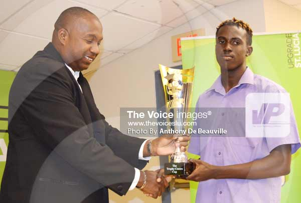 Image: (L-R) Trophy Centre representative Wayne MacDiarmid presenting Dennery Ridel Stanislaus with the Most Outstanding Young Player Award.(Photo Anthony De Beauville)