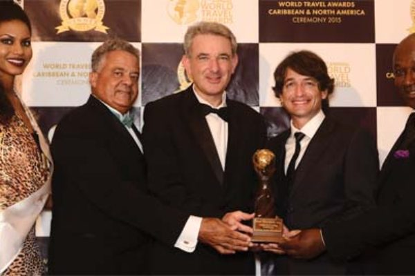 Image- From left to right: World Travel Awards model, Gary Williams; General Manager of Sandals Royal Bahamian Spa Resort & Offshore Island ; Jeremy Mutton, General Manager of Sandals Emerald Baya Spa Golf, Tennis & Spa Resort; RamelSobrino, General Manager of Sandals Ochi Beach Resort and David Latchimy, General Manager of Sandals Negril Beach Resort & Spa