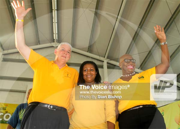 Image: Chastanet, Flood-Beaubrun and Dr. Rigobert thanking the delegates last Sunday. [PHOTO: Stan Bishop]