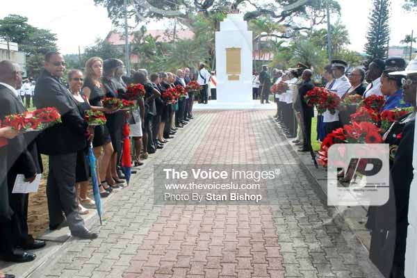 Image: Dignitaries and family members lined up to pay their respects last Sunday.